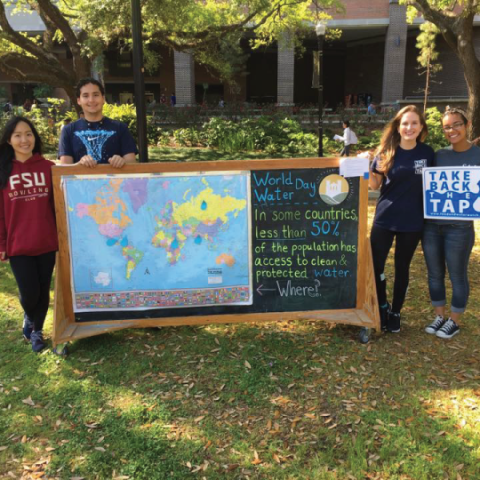 Students with World Water Day Chalkboard Sign