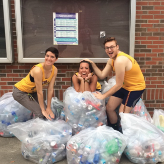 Sustainable Campus Past Program Coordinator with Students and Recyclables