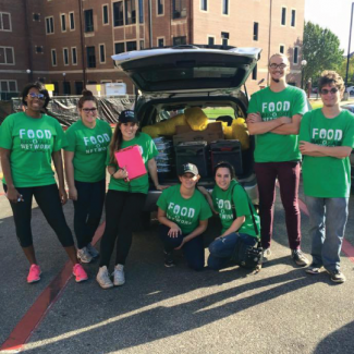 Food Recovery Network Students Next to Car with Donated Food