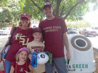 family at football game recycling