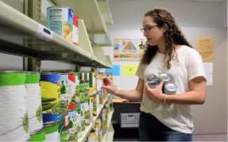 Student inside Food for Thought Pantry