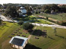 Bird's eye view of sustainability hub solar panels and garden beds